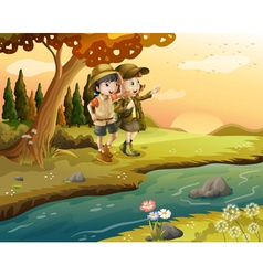 A girl and a boy at the riverbank vector image vector image