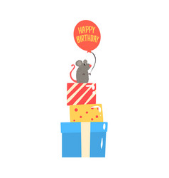 Cute cartoon mouse sitting on colorful gift boxes vector