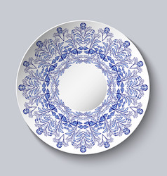 Porcelain plate with a blue floral design vector
