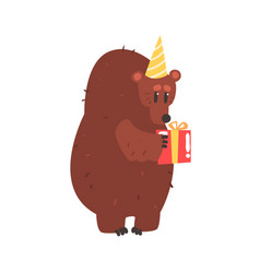 Cute cartoon bear in a yellow party hat holding vector