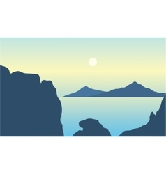 Silhouette of mountain in middle on the sea vector