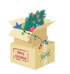 Cardboard box with christmas decorations vector