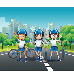 Three kids riding bike on the road vector image