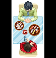 A topview of two people eating sushi vector image vector image