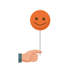 Hand holding smiley face emoticon vector
