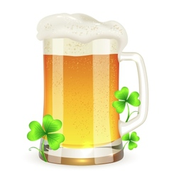 Pint of light beer with clovers vector