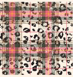 Scottish tartan with leopard skin spots vector