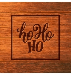 Ho-ho-ho lettering on wooden background vector