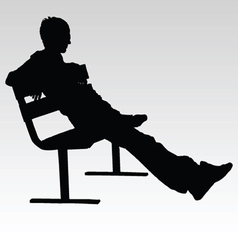 Man sitting on a bench and resting silhouette vector