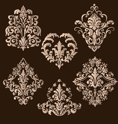 Set of damask ornamental elements vector