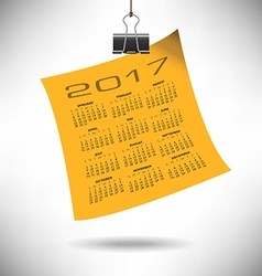 A 2017 calendar note hung by a binder clip vector