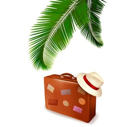 Palm leaves and travel suitcase vector