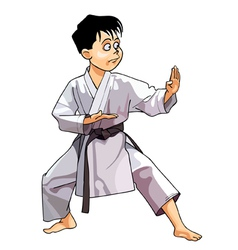 Cartoon karate boy dressed in a kimono standing vector