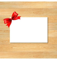 Red Bow And Blank Gift Tag With Wooden Wallpaper vector image