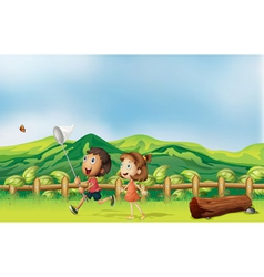 Kids playing across the mountain vector image
