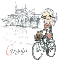 Cute girl rides a bicycle in cordoba vector