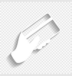Hand holding a credit card white icon vector