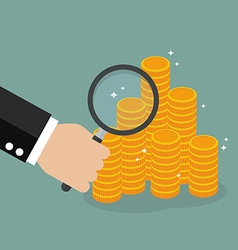 Hand holding magnifying glass with money vector image vector image