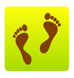 Foot prints sign brown icon at green vector