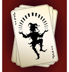 Joker silhouette on playing cards vector image