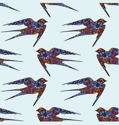 Swallow hand drawing seamless pattern on a blue vector