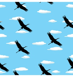 Flying birds and clouds vector