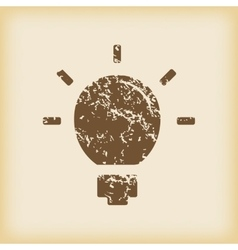 Grungy lightbulb icon vector image
