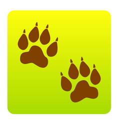Animal tracks sign brown icon at green vector