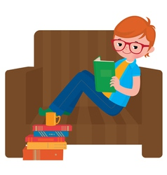 Child boy reading a book sitting in a chair vector image