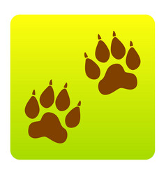 Animal tracks sign brown icon at green vector