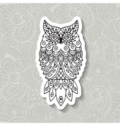 Ethnic pattern with the image of an owl vector