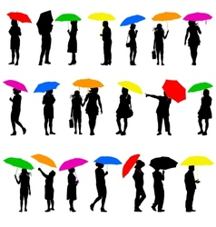 Set silhouettes of men and women with umbrellas vector