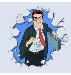 Businessman breaking the wall pop art vector