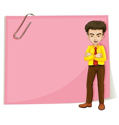 A man in front of a pink empty template with a vector
