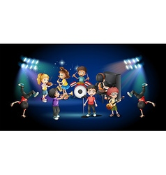 Children in band playing on stage vector