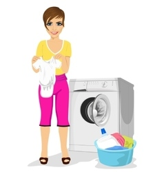 young mother standing next to washing machine vector image vector image