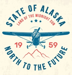 Alaska t shirt with old airplane and mountains vector