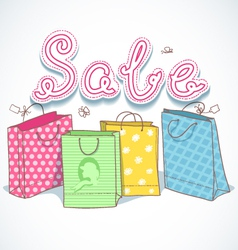 Shopping colorful decorative bags with sale text vector image