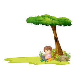 A boy with a laptop under a tree vector image vector image
