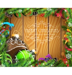 Brown and green christmas balls on wooden vector