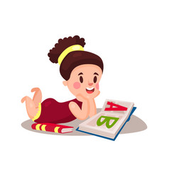 Sweet little girl lying on her stomach and reading vector