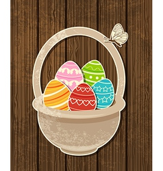 Easter background with eggs in basket vector image