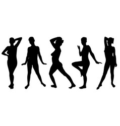 Set of women silhouettes posing vector