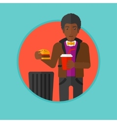 Man throwing junk food vector