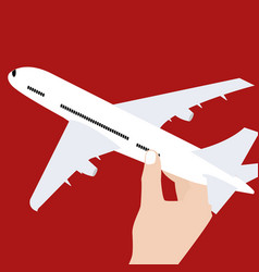 hand holding airplane toy symbol concept of travel vector image