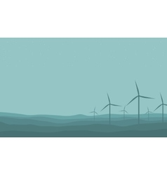 Silhouette of many windmill on farm scenery vector