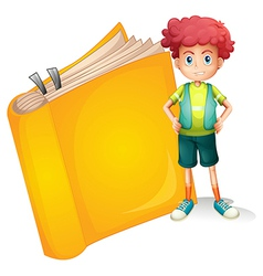 A young curly boy and a big book vector image