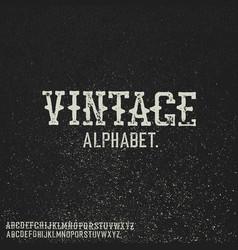 Vintage stamp alphabet on black grunge background vector