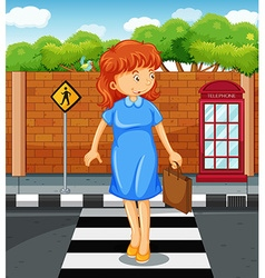 Woman crossing the road vector image vector image