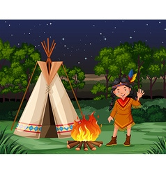 Red indian at the campfire vector image